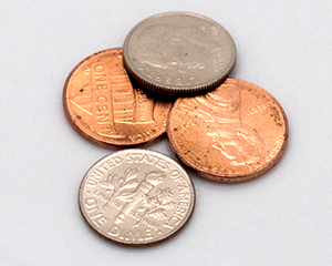 image of two dimes and two pennies